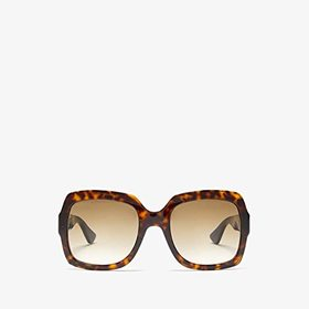 Gucci Gucci - GG0036S. Color Havana. On sale for $