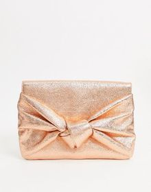 ASOS DESIGN clutch bag with oversized bow in rose